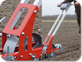 Handlebars to convert a unit to a manual seeder